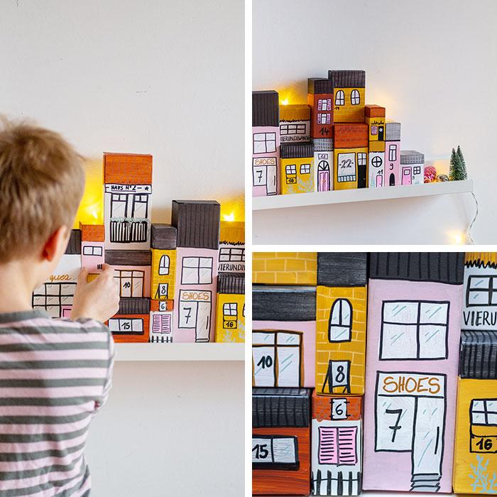 Aus Papp-Verpackungen (zum Beispiel von Lebensmitteln) kannst du mit ein bisschen Farbe und Fantasie einen tollen DIY Adventskalender basteln. Die upcycling Häuserzeile ist zudem noch eine tolle, weihnachtliche Dekoration.